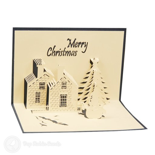 "This card opens to reveal a snowy Christmas scene with a cottage, showman and Christmas tree. The outside has a stencilled ""Merry Christmas"" message."
