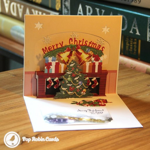 "This warm and colourful Christmas card opens to reveal a pop-up Christmas scene with a cosy hearth, presents, bells, Christmas stockings and a Christmas tree. A ""Merry Christmas"" message appears above. There is an inner card for you to write your own message on which can be slotted in."