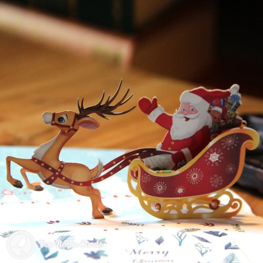 This bright and colourful Christmas card opens to reveal a 3D pop-up scene with Father Christmas being pulled on his sledge by a reindeer. Five cheery snowmen are printed in the background. There is an inner card for you to write your own message on which can be slotted in.