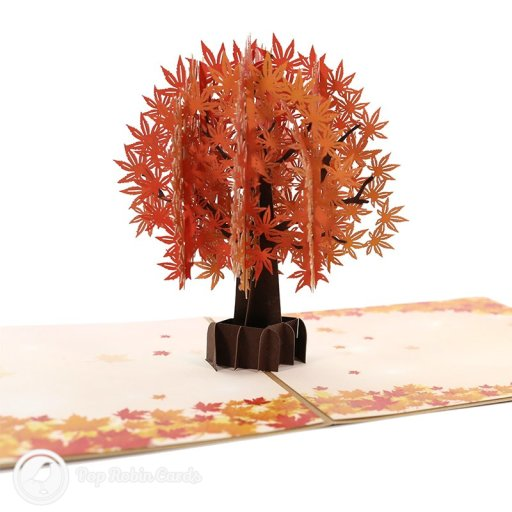 This beautiful card folds flat but opens to reveal a 3D pop-up design showing a tree brimming with autumnal leaves. The inside of the card and cover are decorated with falling leaves.