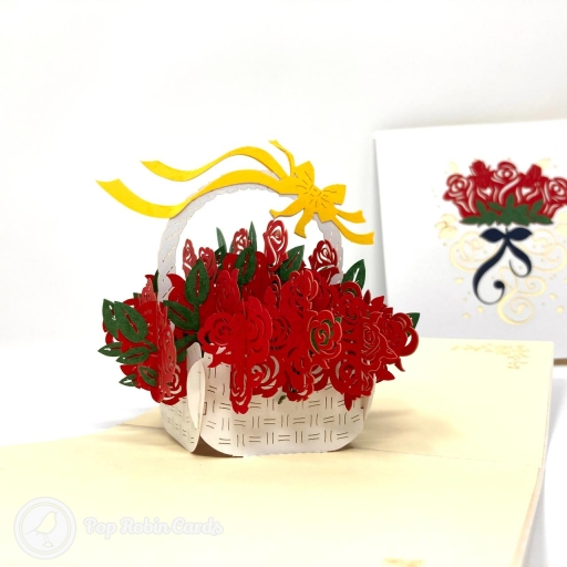 This beautiful greetings card is perfect for all sorts of special occasions with its 3D pop up design showing a basket brimming with vivid red roses and a yellow ribbon on top. The cover has a stylish stencil design showing a bunch of roses with a ribbon.