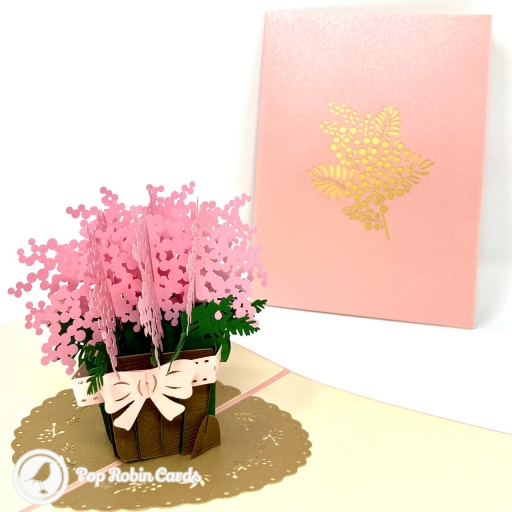This beautiful greetings card is suitable for many occasions with its 3D pop up design showing a basket of vivid pink gypsophila flowers with a cream white ribbon and bow. The cover design shows gypsophila flowers in gold.