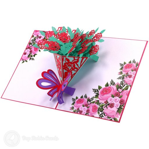 This card opens to reveal a beautiful 3D pop-up design showing a bouquet of bright red roses with green leaves and a purple ribbon. The cover has a stencil design also showing a bouquet of flowers.