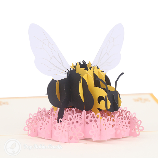 This wonderful card has a 3D pop up design showing a busy bumble bee wobbling around on a bright pink flower. The cover shows a cartoon bumble bee flying to a flower.