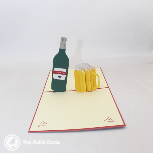 "This 3D pop up card shows a glass of beer and a beer bottle with the words ""I Love You"" written on it. The cover has a stencil design showing a glass of beer."