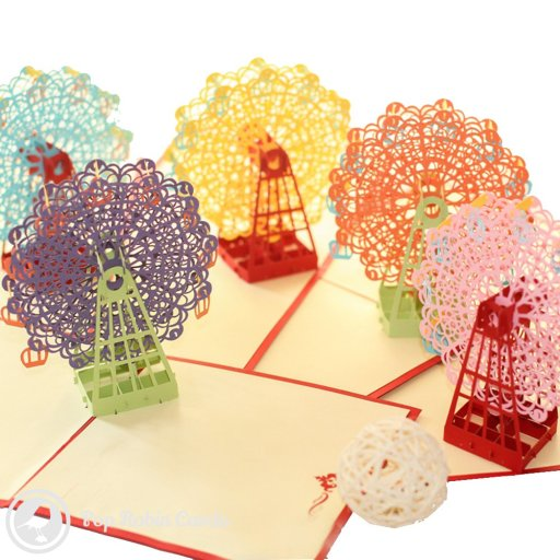 This card opens to reveal a 3D pop-up ferris wheel design, complete with hanging carriages. Available in three colours while stocks last.