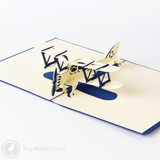 This greetings card opens to reveal an intricate pop-up design showing an old-fashioned biplane with a propeller engine and a star on the tail fin. It's available in red or blue colours and is the perfect card for someone who loves planes and traditional designs.