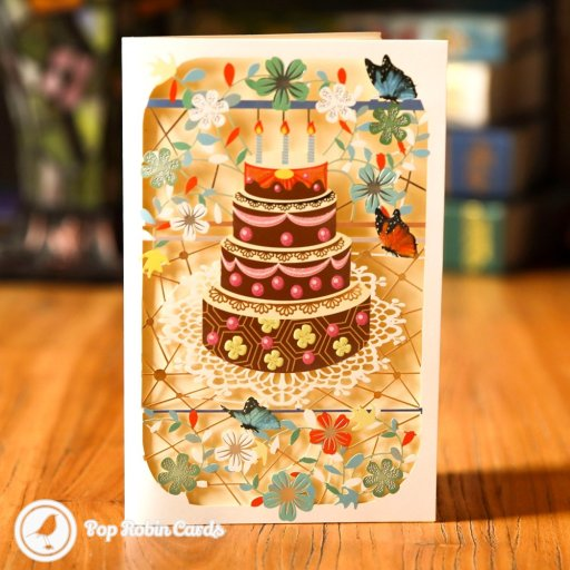 This pretty card has a simple but attractive cut-out design showing a chocolate birthday cake with candles, surrounded by flowers and butterflies.