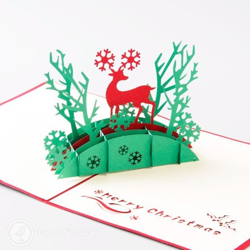 "This beautiful festive Christmas card opens to reveal a 3D pop-up design showing a reindeer with snowy antlers standing on a bridge in a winter forest. A ""Merry Christmas"" message is stenciled to one side. The cover also shows a reindeer in a snow scene in a stencil design."