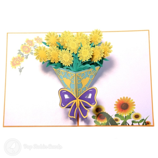 This beautiful 3D pop-up card opens to reveal a bouquet of bright yellow sunflowers bursting from a bouquet decorated with a purple ribbon.