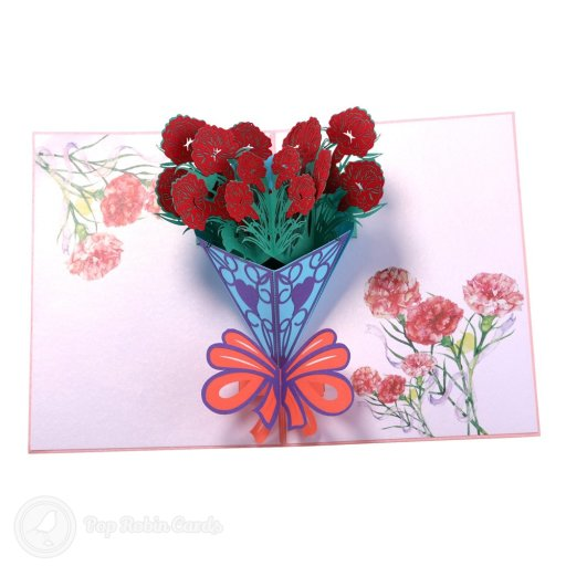 This beautiful card opens to reveal a 3D pop-up design showing a bouquet of red carnation flowers wrapped with ribbons. The cover is floral pink and has a stencil design.