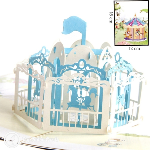 This charming card opens to reveal a 3D pop up design showing a spinning carousel complete with horses and archways. The cover has a painting design showing a fairground in a magical landscape.