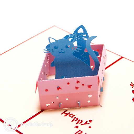 "The cat might have been let out of the bag, but now it's in a cute box in this amusing birthday card. The card opens to reveal a 3D pop-up design showing two blue cats sitting playfully in a pink box, with a ""Happy Birthday"" message stenciled to one side."
