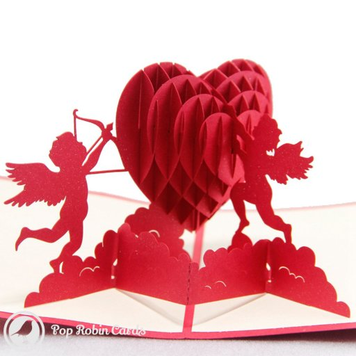 This charming card opens to reveal a 3D pop-up design showing two cherubs around a red heart flying above clouds. The cover also shows cherubs and a red heart in a stencil design.