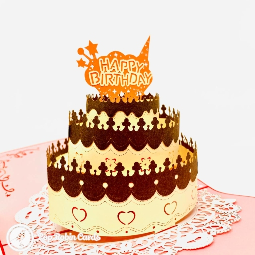 """This tasty-looking birthday card is extra special with its 3D pop up design showing a birthday cake topped with chocolate trimming and a """"Happy Birthday"""" message."""