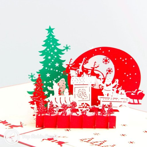 This amazing Christmas card opens to reveal a 3D pop-up design complete with a Christmas tree, Santa's sleigh, reindeer and stenciled snow flakes. The stenciled cover also shows Santa's sleigh and reindeer. This card is sure to delight at Christmas.