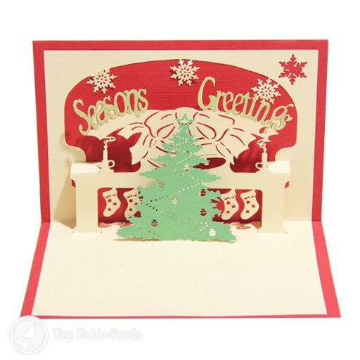 Inside this Christmas is a cosy Christmas scene with a hearth, stockings, a bell and a Christmas tree, all in a 3D pop-out design.