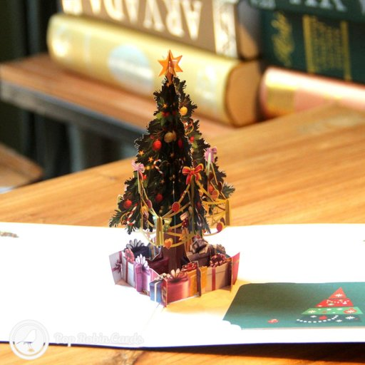 This wonderful Christmas card opens to reveal a 3D pop-up scene showing a colourful Christmas tree surrounded by presents, with holly and baubles in the corners. There's a separate card to write your message on and slot in.