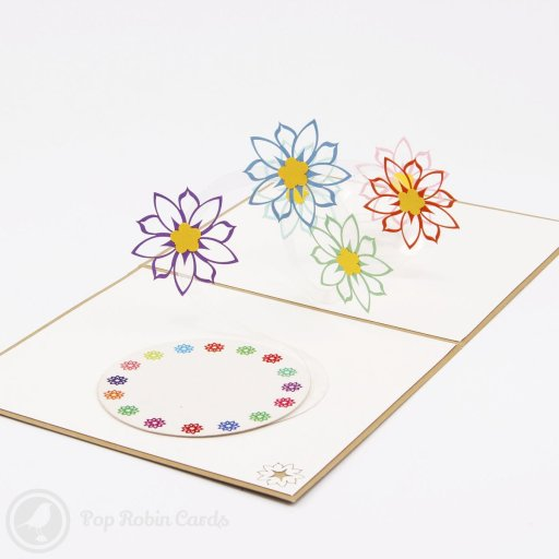 This elegant greetings card opens to reveal a 3D pop-up design with pretty colourful flowers suspended over a printed floral pattern. The cover depicts a bold flower with large petals in a stencil design.