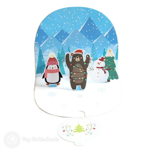 This cute Christmas card opens to reveal a 3D pop-up scene with a penguin, bear and snowman in winter hats with snowy mountains in the background. The cover has a special curved design and shows the bear in a woolly Christmas jumper.