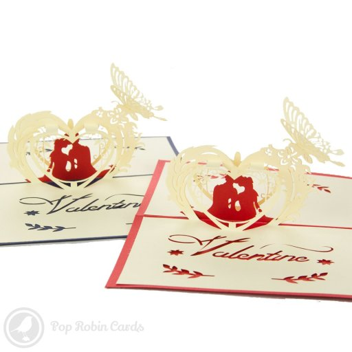 This romantic Valentines card features a 3D pop-up design showing a couple below a floral arch. The cover has a stencil design showing the same couple and is available in blue or red.