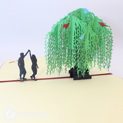 This beautiful card opens to reveal an amazing 3D pop up design showing a couple dancing underneath a green willow tree with red and blue birds perched in its branches. There are swan stencil designs in the corners. The cover has a stencil design showing the same scene.
