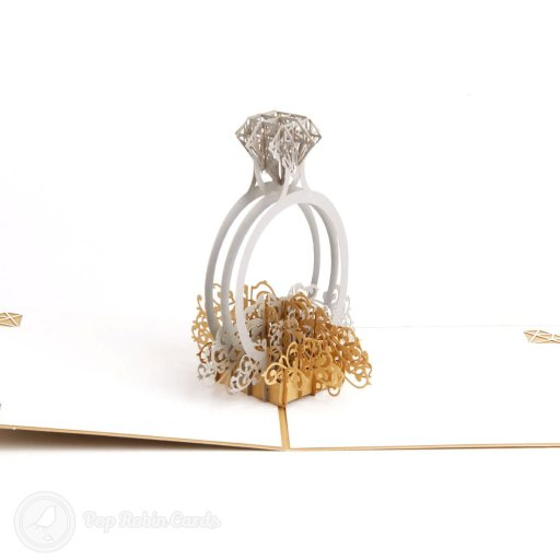 This card makes an amazing congratulations card for an engagement, marriage or wedding. It opens to reveal a 3D pop-up silver engagement ring topped with a diamond sitting on a decorative floral design.