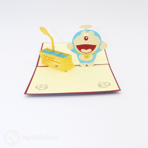This cute card has a 3D pop up design showing Doraemon, the famous blue manga character. The cover has a stencil design also showing Doraemon.