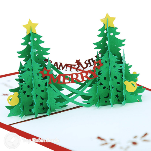 "This lovely Christmas card opens to reveal a 3D pop up design showing two green Christmas trees with the words ""Merry Christmas"" strung between them. The cover has a stencil design with a ""Merry Christmas"" message."
