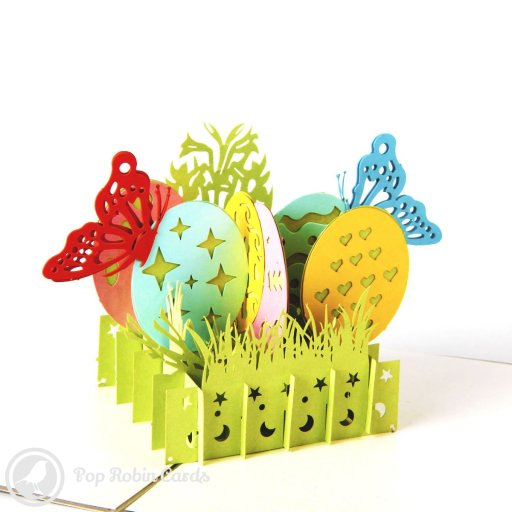 This charming Easter greetings card opens to reveal a 3D pop-up design showing colourful decorated Easter eggs and butterflies in a floral basket. The cover also has an Easter egg stencil design.
