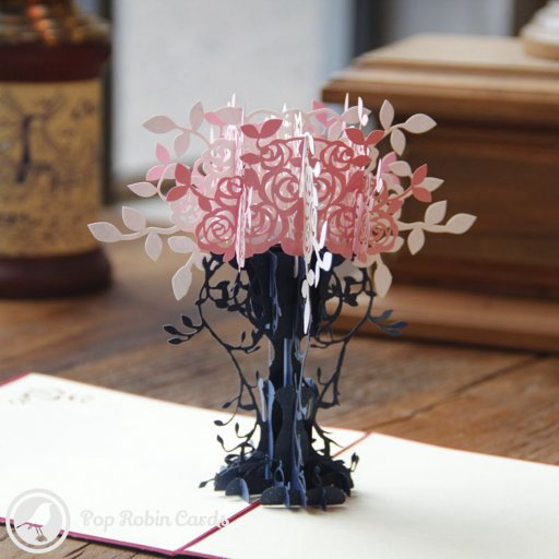 This beautiful greetings card opens to reveal a stunning 3D pop-up design showing a tall and elegant vase brimming with colourful flowers.