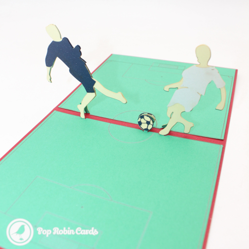 This 3D pop up card is perfect for football fans and players, with its miniature football pitch, players and football. The cover has a stencil design showing a football player.