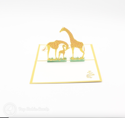 This cute greetings card has a 3D pop up design showing two parent giraffes with a small calf between them in a grassy savanah. The cover has a stencil design also showing a giraffe.