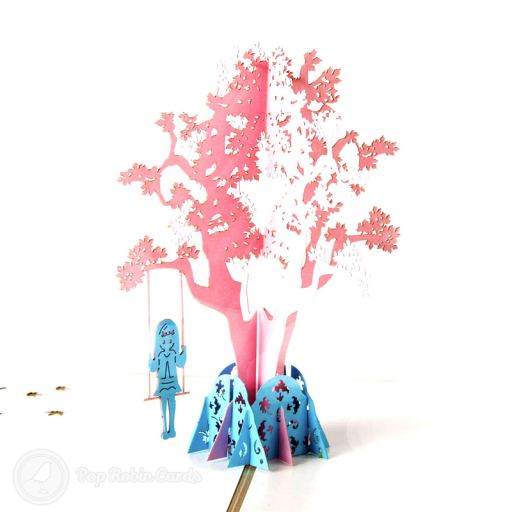 This charming card has a 3D pop up design showing a girl on a swing below a tree. The cover has a stencil design showing the same scene.