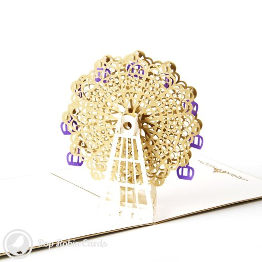 This amazing greetings card opens to reveal an intricate 3D pop-up design with a detailed ferris wheel in gold and purple colours. The cover has a stencil ferris wheel design.
