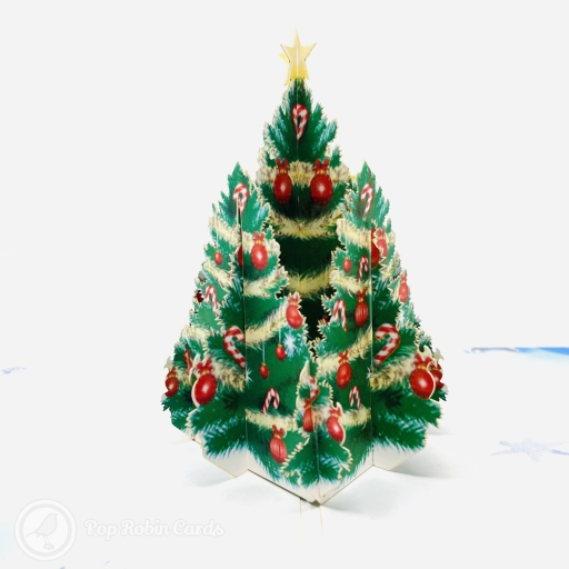 This colourful Christmas card has a 3D pop up design showing a green Christmas tree decorated with red baubles and yellow tinsel and a star on top.