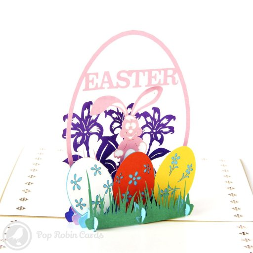 "This bright and colourful card is perfect for Easter with its 3D pop-up design showing the Easter bunny and cheerily decorated Easter eggs. The cover has a stenciled ""Happy Easter"" design."