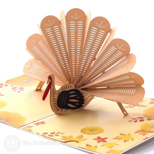 "This festive card is perfect for Thanksgiving with its amazing 3D pop-up design showing a fat turkey surrounded by pumpkins and autumnal leaves. The cover has a ""Happy Thanksgiving"" message."