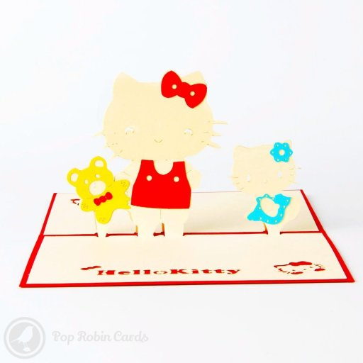 This greetings card couldn't be cuter with its 3D pop-up design showing Hello Kitty and two friends. A Hello Kitty design is stenciled to one side and on the front cover of the card.