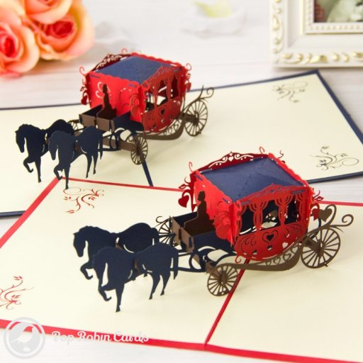 This beautiful card opens to reveal an ornate horse-drawn carriage with a driver, a passenger and two horses. The carriage is decorated with hearts.