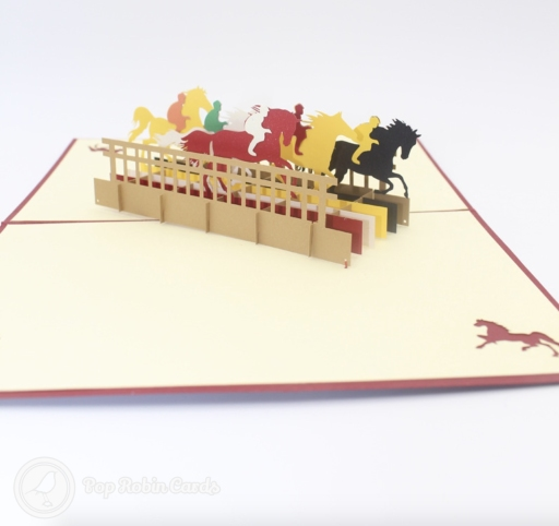 This exciting card opens to reveal a 3D pop up design showing a horse race with several jockeys riding multi-coloured horses through a course. The cover has a stencil design showing a horse galloping.
