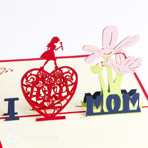 "This cute Mother's Day card has a 3D pop up design showing a red heart, a girl holding flowers and the words ""I Love Mom"". The cover has a stencil design showing a heart containing the word ""Love""."