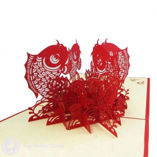 This beautiful 3D pop-up greeings card opens to reveal four symmetrical fish leaping from stencilled water. The intricate design is laser-cut in red card for an exquisite finish.