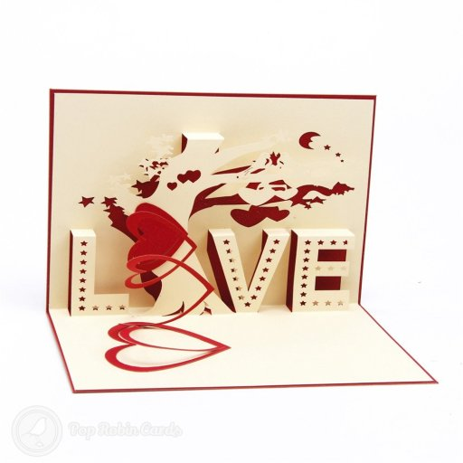 "This romantic card is sure to delight with its 3D pop-up design showing the word ""love"", a red heart and a tree with a songbird. The cover has a stylish stencil design."