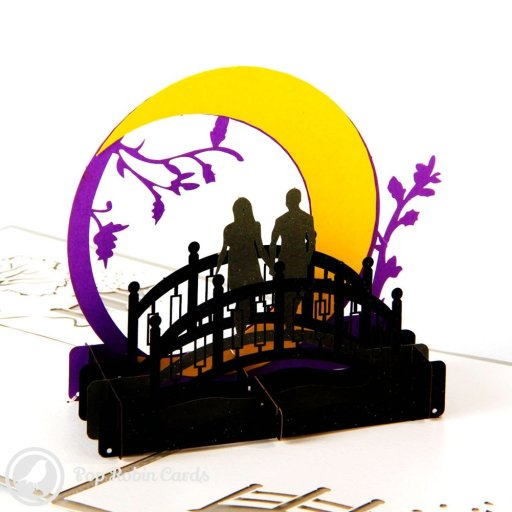 This romantic card features a 3D pop-up design showing a silhouetted couple standing on a bridge below a bright moon. The cover has a stencil design showing the couple in the moonlight.