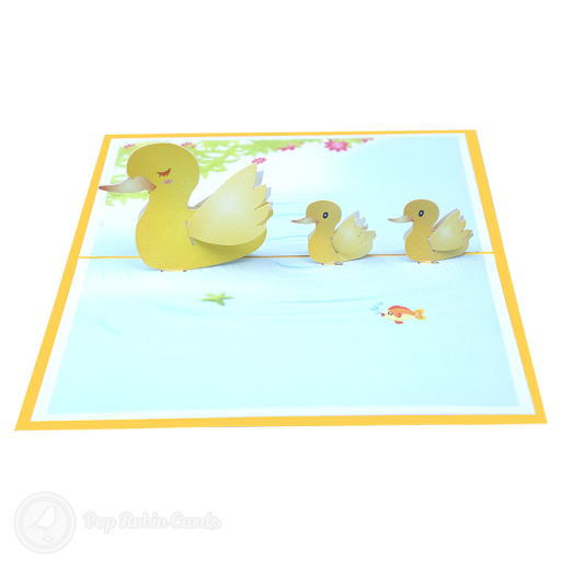 This cute card is sure to delight with its 3D pop up design showing a mother duck and two ducklings swimming together. The cover has a stencil design also showing a duckling.