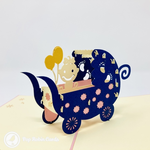 This cute card is perfect as a new baby congratulations card with its 3D pop up design showing a baby in a pram. There's a choice of two colours for the cover.