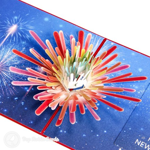 """This New Years celebration card opens to reveal a stunning 3D pop-up design showing fireworks exploding in a starry sky. The card and cover both show a """"Happy New Year"""" message, and there is a smaller card to enclose with your own message."""