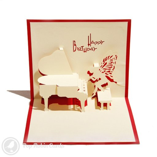 "This musical-themed greetings card shows a grand piano being played by a winged fairy in a 3D pop-up design. The card is available with a red or blue cover, which also shows a piano and a ""Happy Birthday"" message in a stencil design."