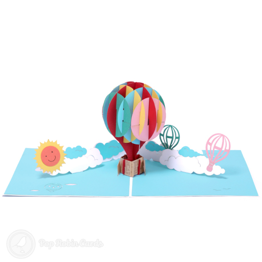 This colourful greetings card opens to reveal a 3D pop-up design showing a hot air balloon in bright rainbow colours.